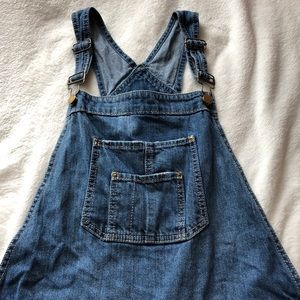 American Rag distressed denim overalls.